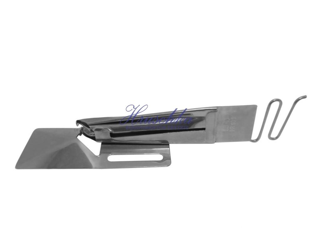 Aparelho de debrum com uma vira para máquina base plana